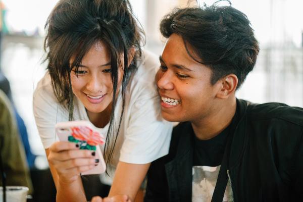 Teenagers looking at phone